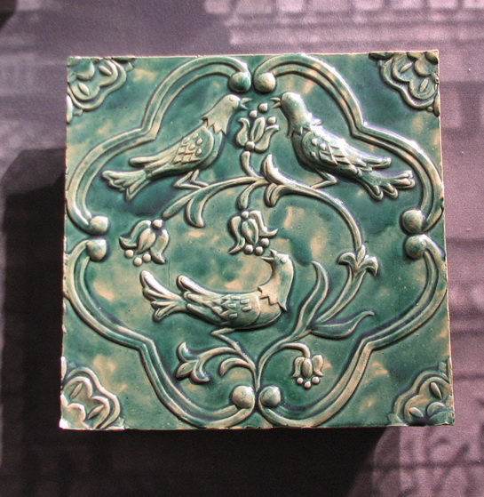 Tile from a Belarussian website.  This tile is decorated with a relief design.
