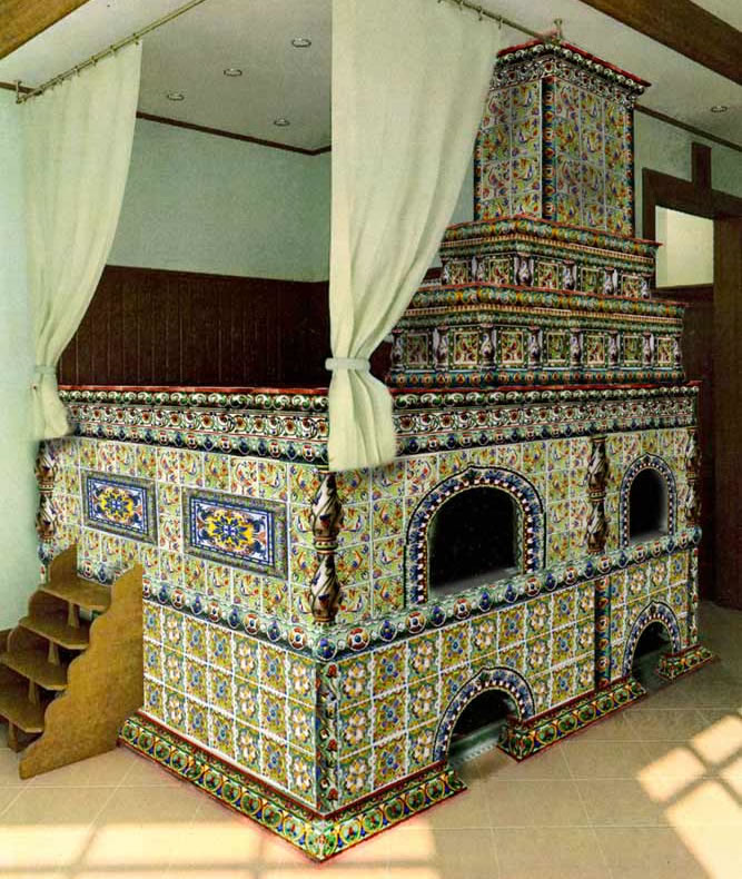 A spectacular example of a tile-covered Russian stove, in the peasant style with a space for sleeping on top. See more about these tiles and stoves below.
